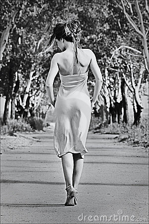 Girl walking along the avenue