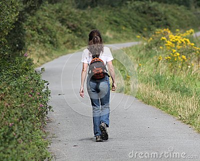 Girl Walking along Path
