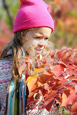 Girl walking in autumn forest
