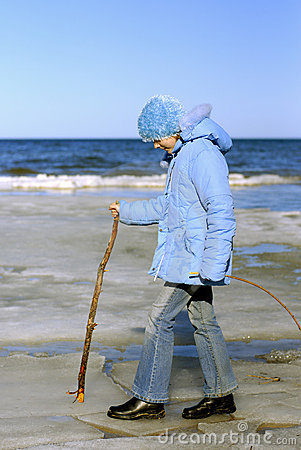 Girl walking at Baltic-Sea