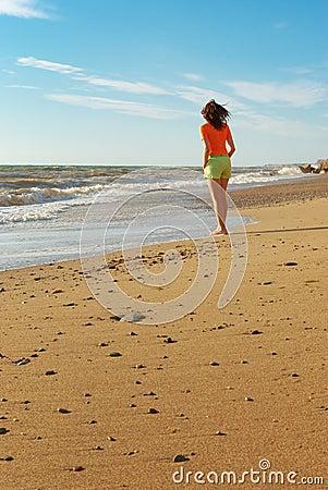 Girl walking on the beach