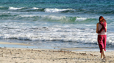 Girl Walking on beach Editorial Stock Image