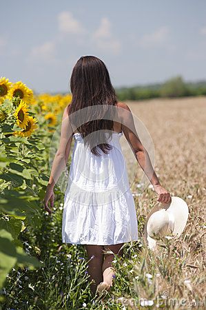 Girl walking in a cropland
