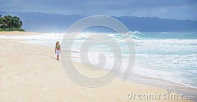 Girl walking on deserted beach