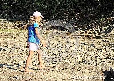 Girl walking on dry ground