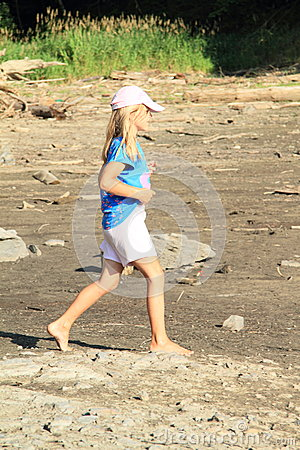 Girl walking on drying ground