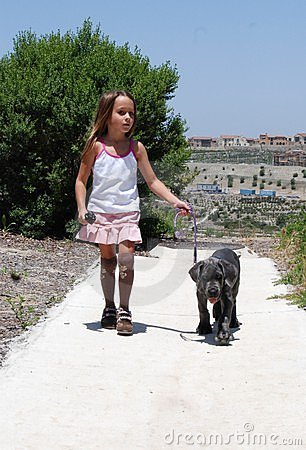 Girl walking her dog