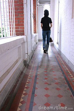 Free Girl Walking In A Long Corridor Royalty Free Stock Photography - 962027
