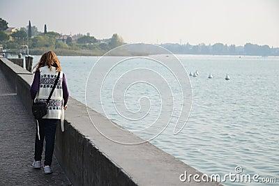 Girl walking on the lakeside