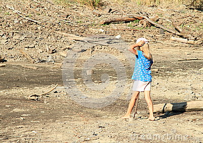 Girl walking in mud
