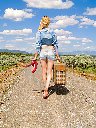 Free Girl Walking On A Dirt Road With A Suitcase Stock Photography - 9886712