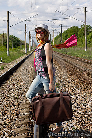 Girl walking on railroad
