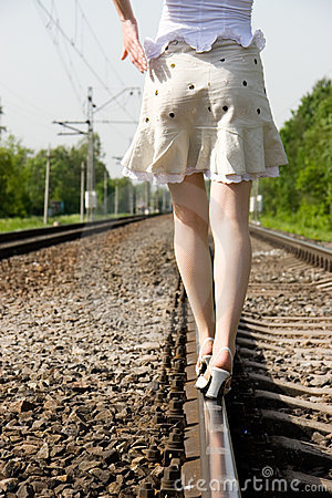 Girl walking on a railway