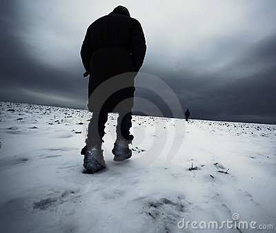 A girl walking on show field