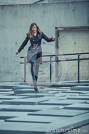 Girl walking on the slabs