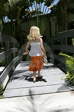 Girl walking in tropical scene