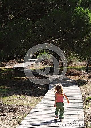 girl walking up path