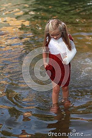 Girl walking in a water