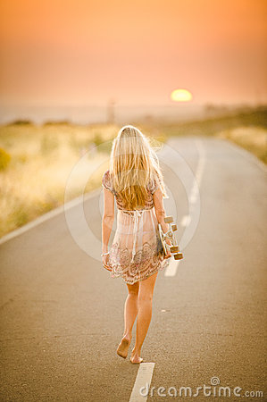 Free Girl Walking With Her Skateboard Royalty Free Stock Image - 24495226