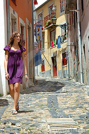 Girl walks portugal street