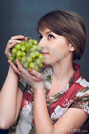 The girl is wanting green grapes