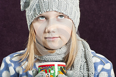 Girl with a warm drink
