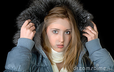 The girl in  warm jacket with a hood