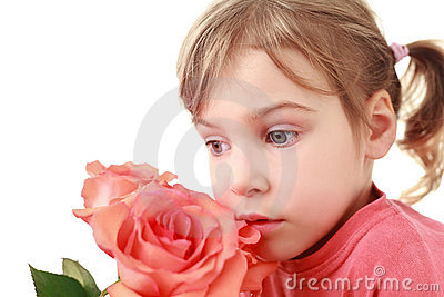 Girl  was concentrated and smells large rose
