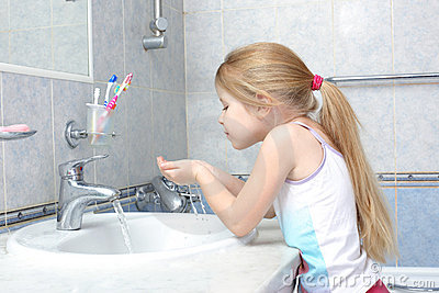 Girl washing in bathroom