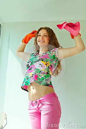 Girl washing the window