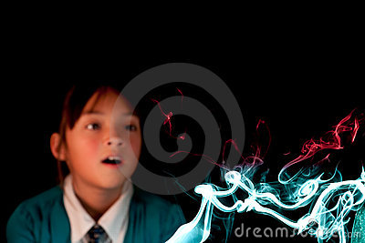 Girl watches colorful smoke.