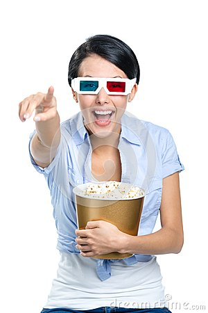 Girl watching 3D cinema with bowl of popcorn