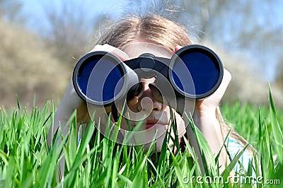 Girl watching binoculars