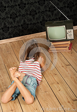 Girl watching old tv