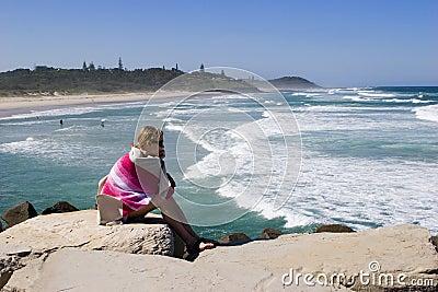 Girl watching surfers