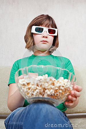 Girl watching TV movies in 3D stereo glasses