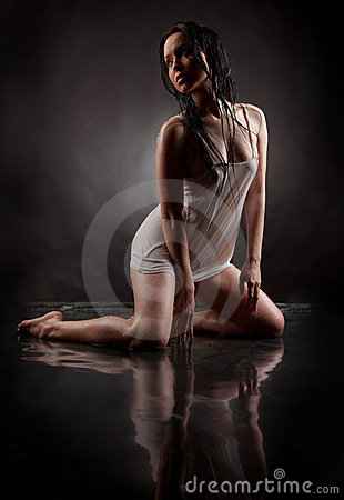Girl in water on a black background.