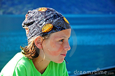 Girl by water wearing headscarf