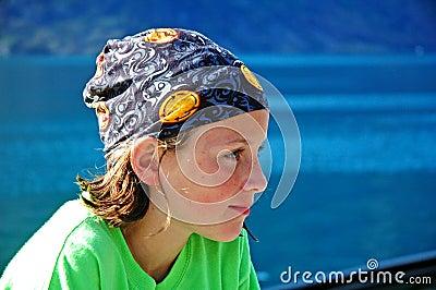 Girl by water wearing headscarf