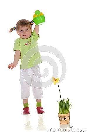 Girl watering the flower