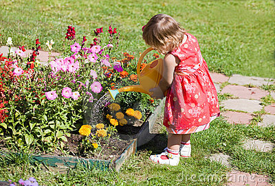 Girl watering flower beds