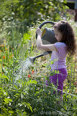 Free Girl Watering The Garden Royalty Free Stock Photos - 26139208