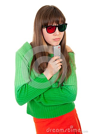 Girl wearing 3D glasses holding remote control