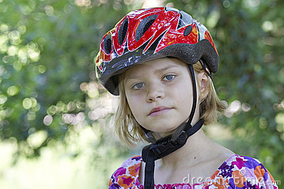 Girl wearing a bike helmet - portrait