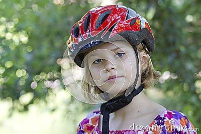 Girl wearing a bike helmet - portrait
