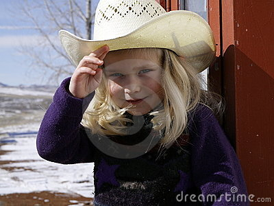 Girl wearing cowboy hat