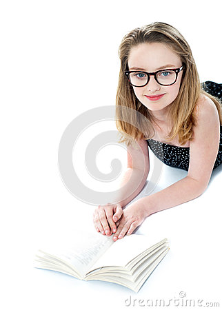 Girl wearing eyeglasses and reading book