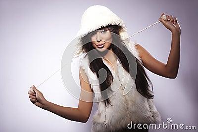 Girl wearing fur lined coat hood