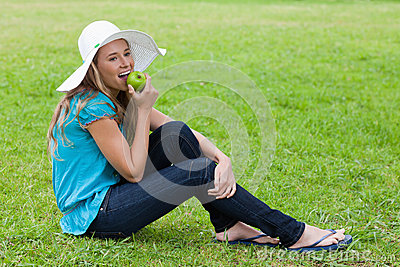 Girl wearing a hat while sitting down