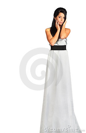Girl wearing long silver dress looks enigmatic